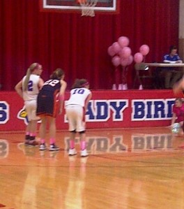 "Rachelle playing during the 2013 ""Think Pink"" basketball game against a neighboring school.  The money raised by selling t-shirts was donated to a local teacher who is fighting breast cancer."