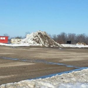 This was one of the many snow piles on our farm before last night's storm hit.  These piles are much bigger now and our driveways are still packed with snow.