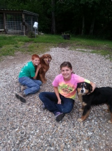 The kids enjoying some down time with their dogs this summer.
